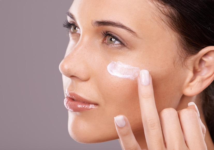 Beautiful Woman Applying Primer to her face
