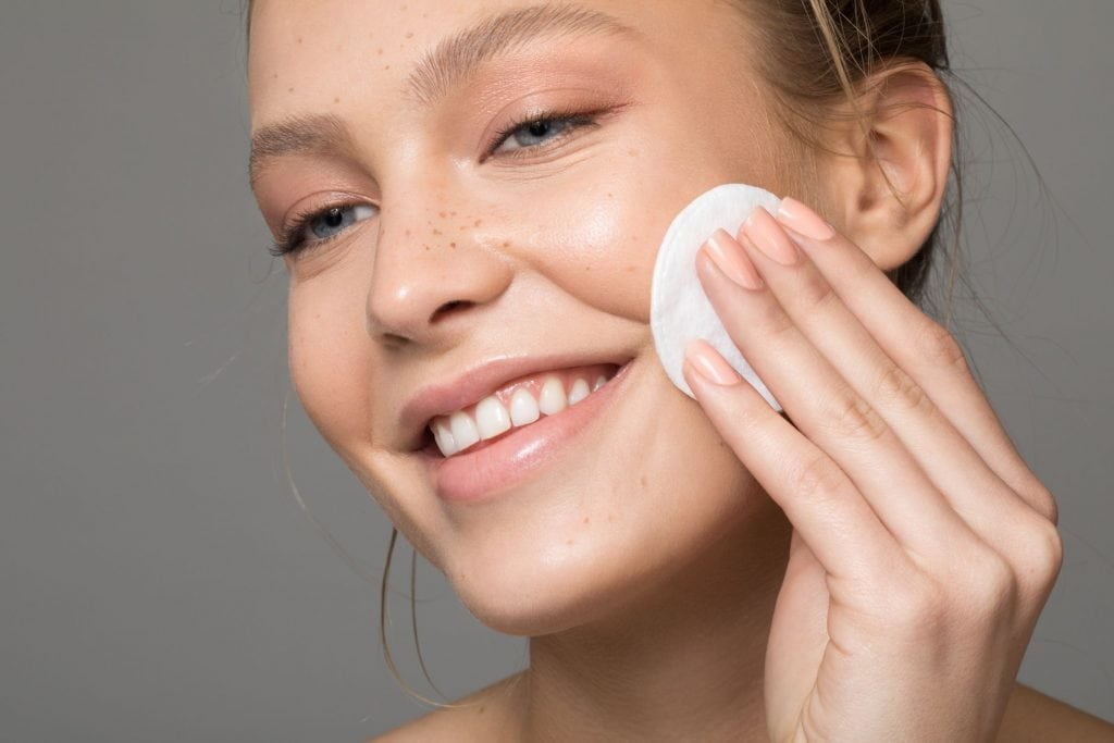 Woman applying a toner picture